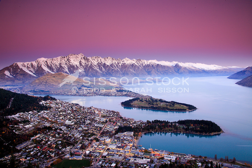 Sunset over the Remarkables and Queenstown from Skyline viewing platform, South Island, New Zealand
