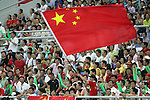 10 August 2008: China fans wave a flag in the stands during the game.  The men's Olympic soccer team of Belgium defeated the men's Olympic soccer team of China 2-0 at Shenyang Olympic Sports Center Wulihe Stadium in Shenyang, China in a Group C round-robin match in the Men's Olympic Football competition.