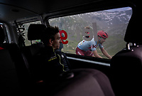 Adam Yates (GBR/Mitchelton-Scott) in the teamcar at the top of the Col de l'Iseran (HC/2751m/13km@7.3%) <br /> > where the race was stopped (at the top) because of landslides further up the road (after a severe hail storm in Tignes)<br /> and seeing how very last rider of the race, Jens Debusschere (BEL/Katusha Alpecin), is still trying to reach the top within the time cut (if that would be taken into account in this chaotic moment...<br /> <br /> Stage 19: Saint-Jean-de-Maurienne to Tignes (126km)<br /> 106th Tour de France 2019 (2.UWT)<br /> <br /> ©kramon