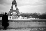 A view of the Eiffell Tower in Paris France with man back to camera