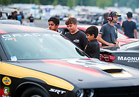 Aug 30, 2019; Clermont, IN, USA; Young fans talk to NHRA factory stock driver Leah Pritchett during qualifying for the US Nationals at Lucas Oil Raceway. Mandatory Credit: Mark J. Rebilas-USA TODAY Sports