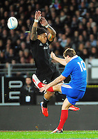 Ma'a Nonu tries to charge down Camille Lopez's up-and-under during the international rugby match between the New Zealand All Blacks and France at Eden Park, Auckland, New Zealand on Saturday, 8 June 2013. Photo: Dave Lintott / lintottphoto.co.nz
