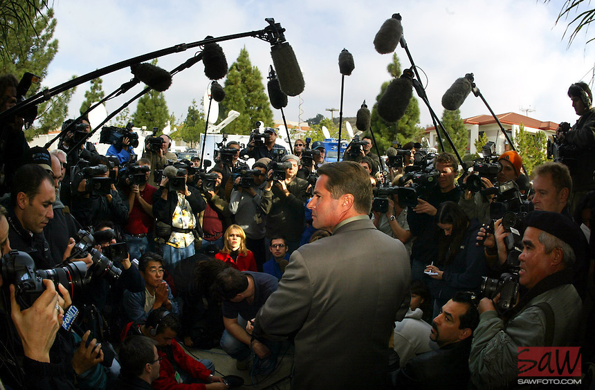 A large crowd of international media listen as Santa Barbara Sherriff PIO Chris Pappas (cq) speaks at press conference Thursday regarding Michael Jackson possibly turning himself in today. Jackson is wanted for multiple counts of child molestation