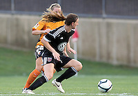 BOYDS, MARYLAND-JULY 07,2012:  Andi Sullivan (24) of DC United Women pushes past Emilie Fillion (13) Dayton Dutch Lions during a W League game at Maryland Soccerplex, in Boyds, Maryland. DC United women won 4-1.