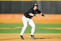 Pat Blair #11 of the Wake Forest Demon Deacons takes his lead off of second base against the Miami Hurricanes at Gene Hooks Field on March 19, 2011 in Winston-Salem, North Carolina.  Photo by Brian Westerholt / Four Seam Images