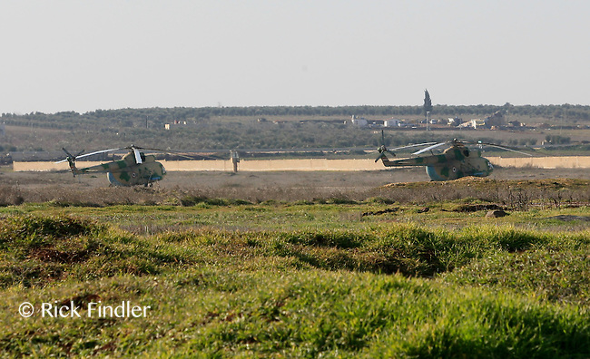 Photographer: Rick Findler/Borderline News..17.01.13 Military helicopters parked at minnagh Military Airport. Free Syirna Army soldiers attempted a mission to have a closer look at Minnagh Military Airport. They are hoping to plan an offensive attack to take the airport from Assad control outside of Aleppo, Northern Syria.