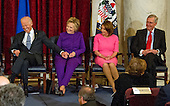 From left to right: United States Vice President Joe Biden, former US Secretary of State Hillary Clinton, US House Minority Leader Nancy Pelosi (Democrat of California) and US Senate Majority Leader Mitch McConnell (Republican of Kentucky) react during the ceremony where the official portrait of US Senate Minority Leader Harry Reid (Democrat of Nevada) is to be unveiled in the Kennedy Caucus Room on Capitol Hill in Washington, DC on Thursday, December 8, 2016.<br /> Credit: Ron Sachs / CNP