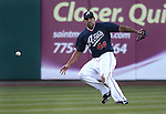 Reno Aces left fielder Juan Rivera chases down a loose ball during a minor league baseball game against the Sacramento River Cats in Reno, Nev., on Wednesday, June 12, 2013. Sacramento won 9-7.<br /> Photo by Cathleen Allison