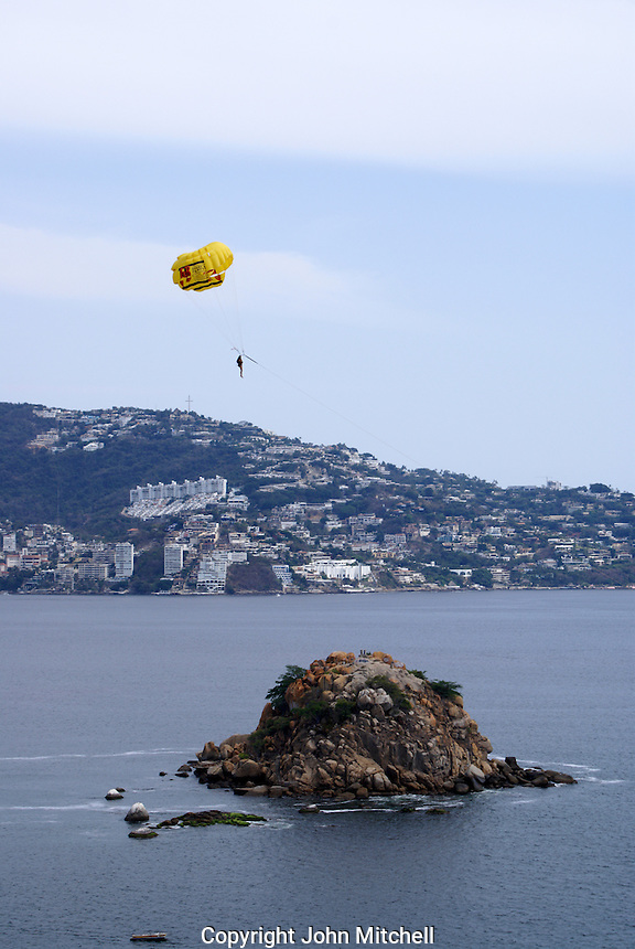Person parasailing above Acapulco Bay, Acapulco, Mexico