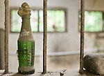 An old sprite bottle sits decoratively on this window sill.