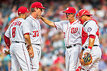 15 June 2016: Washington Nationals pitching coach Mike Maddux comes to the mound to have words with Stephen Strasburg during game action against the Chicago Cubs at Nationals Park in Washington, DC. The Nationals defeated the Cubs 5-4 in 12 innings to take the rubber match of their 3-game series. Mandatory Credit: Ed Wolfstein Photo *** RAW (NEF) Image File Available ***