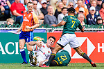Mfundo Ndhlovu of South Africa (H) puts a tackle on Callum Sirker of England (L) during the HSBC Hong Kong Sevens 2018 match between South Africa and England on April 7, 2018 in Hong Kong, Hong Kong. Photo by Marcio Rodrigo Machado / Power Sport Images