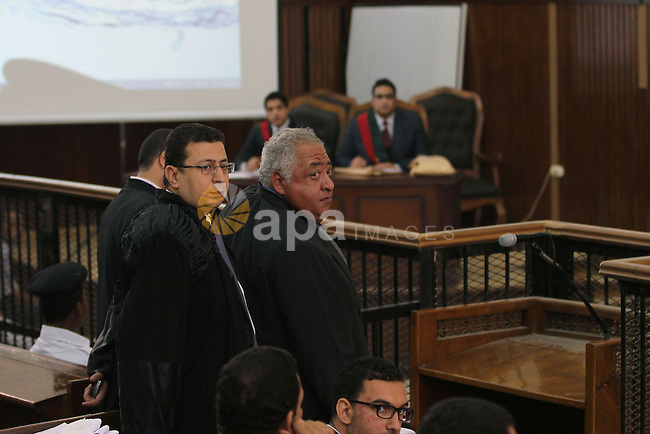 Members of defense authority of defendants in the Marriott terror cell case attend the trial in Cairo on May 22, 2014. A total of 20 defendants in the case are charged with harming Egypt's national interests by spreading false news and assisting or belonging to a terrorist organization, but 12 are being tried in absentia. Photo by Mohammed Bendari