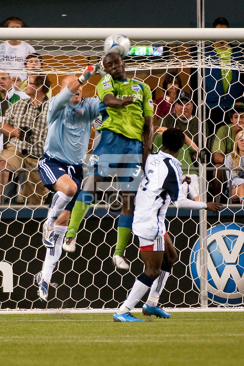 Jhon Kennedy Hurtado (c) of the Seattle Sounders shoots against goalkeeper Matt Ries (l) and Emmanuel Osai (r) of the New England Revolution in the match at the XBox Pitch at Quest Field on August 20, 2009. The Revolution defeated the Sounders 1-0.