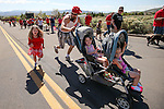 Jaelynn Smith, 6, races her friend Mazzerick Nelson as he pushes his daughters Larissa, 2, and Julia, 1, up the hill to Western Nevada College as several hundred people participate in a Veterans Suicide Awareness event in Carson City, Nev., on Saturday, May 2, 2015.<br /> Photo by Cathleen Allison
