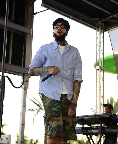 SUNRISE, FL - DECEMBER 20: Travie McCoy performs at Y100's Pre-Show at the Jingle Ball Village on the plaza at the BB&T Center on December 20, 2013 in Sunrise, Florida. . © MPI10/MediaPunch Inc
