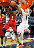Virginia guard Tiffany Suarez (13) tries to block the shot of Maryland guard Laurin Mincy (1) during the game Thursday in Charlottesville, VA. Virginia defeated Maryland 86-72. Photo/The Daily Progress/Andrew Shurtleff