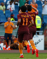 Calcio, Serie A: Roma vs Udinese. Roma, stadio Olimpico, 20 agosto 2016.<br /> Roma&rsquo;s Diego Perotti, right, celebrates with teammate Mohamed Salah after scoring on a penalty kick during the Italian Serie A football match between Roma and Udinese at Rome's Olympic Stadium, 20 August 2016. Roma won 4-0.<br /> UPDATE IMAGES PRESS/Riccardo De Luca