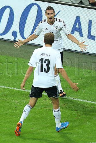 06.09.2013. Allianz Arena, Munich, Germany.  Germany's Miroslav Klose (top) celebrates with team mate Thomas Mueller after scoring the opening goal during the FIFA World Cup 2014 qualification group C soccer match between Germany and Austria .
