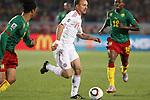 19 JUN 2010: Dennis Rommedahl (DEN) (19) moves between Benoit Assou-Ekotto (CMR) (2) and Eyong Enoh (CMR) (18). The Cameroon National Team lost 1-2 to the Denmark National Team at Loftus Versfeld Stadium in Tshwane/Pretoria, South Africa in a 2010 FIFA World Cup Group E match.