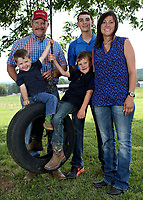 NWA Democrat-Gazette/DAVID GOTTSCHALK  Allen and Cindy Moore stand Tuesday, June 13, 2017, with their sons Hudson (from left), 2, Kipton, 6, and Cameron, 15, on at the more than 500 acre Moore Valley Farms near Lincoln. The family was named the 2017 Washington County Farm Family of the Year.