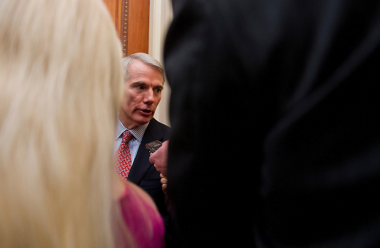 UNITED STATES - Jan 14: Sen. Rob Portman, R-OH., talks with reporters on the way to the Senate policy luncheons in the U.S. Capitol on January 14, 2014. (Photo By Douglas Graham/CQ Roll Call)