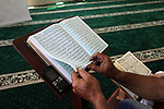 A Palestinian man reads the Koran, Islam's holiest book, at a mosque in Gaza City on the Muslim holy month of Ramadan, on May 20, 2018. Ramadan is sacred to Muslims because it is during that month that tradition says the Koran was revealed to the Prophet Mohammed. The fast is one of the five main religious obligations under Islam. Muslims around the world will mark the month, during which believers abstain from eating, drinking, smoking and having sex from dawn until sunset. Photo by Mahmoud Ajour