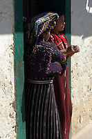 Two women chat in a doorway in Chajul.
