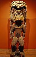 An ancient carving of Ku, one of the major Hawaiian gods, on display at Bishop Museum, Honolulu