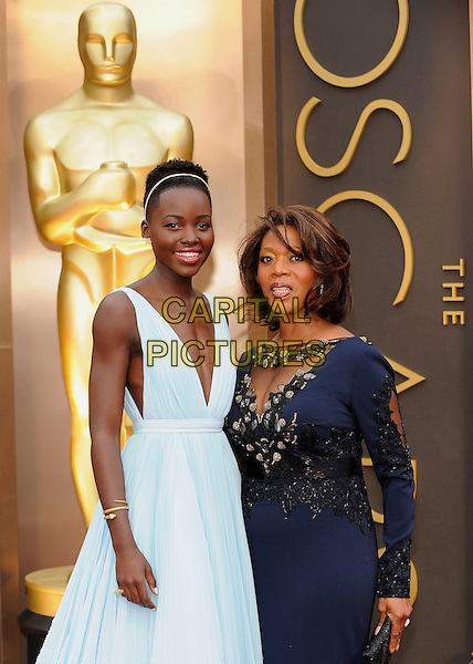 HOLLYWOOD, CA - MARCH 2: Lupita Nyong'o (wearing Prada), Alfre Woodard arriving to the 2014 Oscars at the Hollywood and Highland Center in Hollywood, California. March 2, 2014.  <br /> CAP/MPI/mpi99<br /> &copy;mpi99/MediaPunch/Capital Pictures