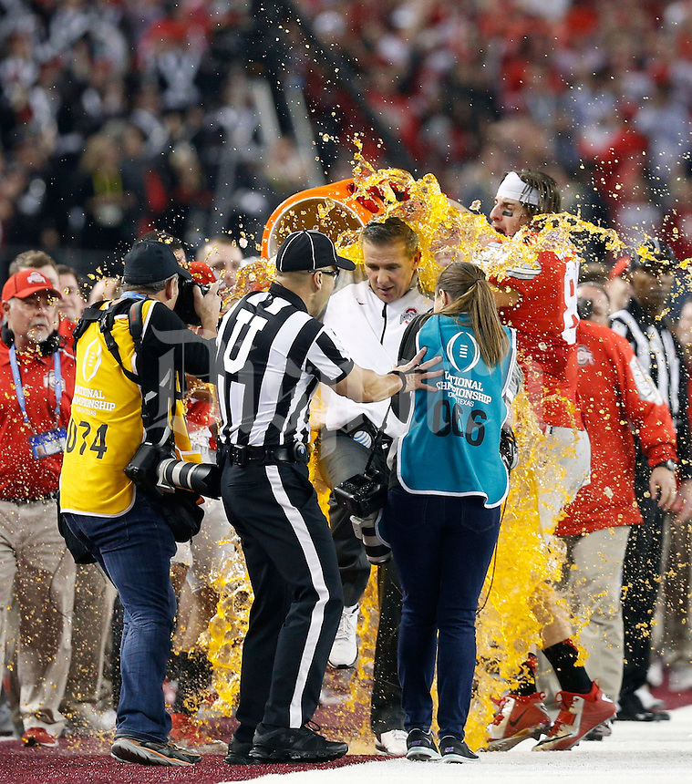 Ohio State Buckeyes tight end Nick Vannett (81) dumps gatorade on Ohio State Buckeyes head coach Urban Meyer  celebrate beating Oregon Ducks 42-20 in College Football Playoff Championship game at AT&T Stadium in Arlington, Texas on January 12, 2015.  (Dispatch photo by Kyle Robertson)