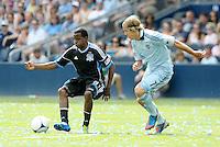 San Jose midfielder Marvin Chavez (81) holds the ball up against Kansas City defender Chance Myers... Sporting Kansas City defeated San Jose Earthquakes 2-1 at LIVESTRONG Sporting Park, Kansas City, Kansas.