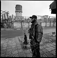 Gaza city, January 23, 2009.Hamas militiaman stands guard in front of the main Gaza city prison, destroyed by Israeli bombs.