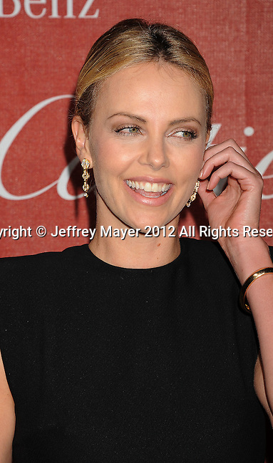 PALM SPRINGS, CA - JANUARY 07: Charlize Theron arrives at the 2012 Palm Springs Film Festival Awards Gala at the Palm Springs Convention Center on January 7, 2012 in Palm Springs, California.