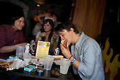 Sondre Lerche takes time for lunch between sets with his friends at Casino El Camino in downtown Austin, Texas during the 2011 SXSW Music Festival.