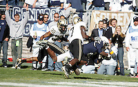 State College, PA -- 11/3/2007 --  Derrick Williams dives between Purdue defenders David Pender (35) and Brandon King (7) to score a touchdown in the fourth quarter, putting Penn State ahead 19-16.  Penn State defeated Purdue by a score of 26-19 on Saturday, November 3, 2007, at Beaver Stadium.  Williams had 10 receptions for 95 yards during the game...Photo:  Joe Rokita / JoeRokita.com