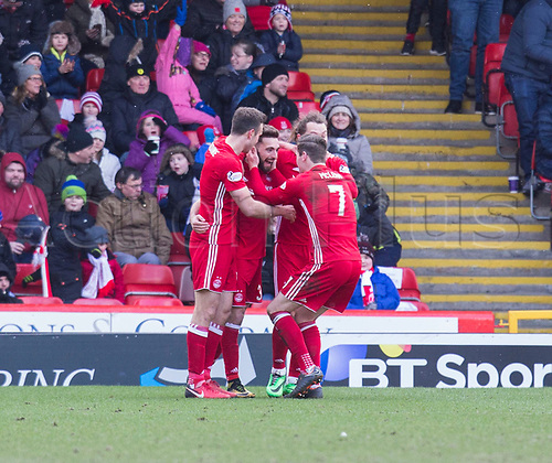 17th March 2018, Pittodrie Stadium, Aberdeen, Scotland; Scottish Premier League football, Aberdeen versus Dundee; Graeme Shinnie of Aberdeen is congratulated after scoring for 1-0