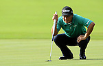 TAIPEI, TAIWAN - NOVEMBER 20:  Lu Chien Soon of Taiwan lines up a putt on the 9th hole during day three of the Fubon Senior Open at Miramar Golf & Country Club on November 20, 2011 in Taipei, Taiwan. Photo by Victor Fraile / The Power of Sport Images