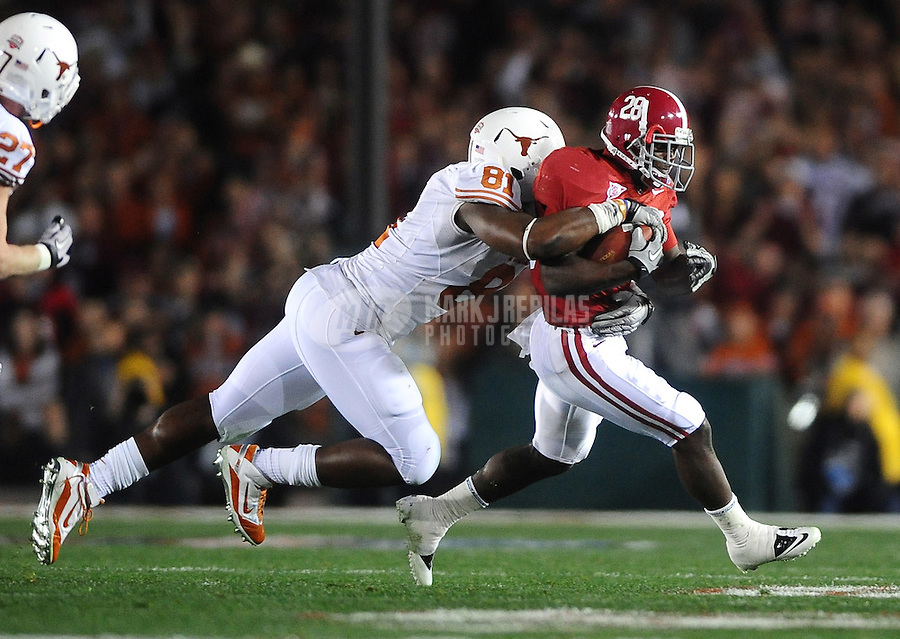 Jan 7, 2010; Pasadena, CA, USA; Alabama Crimson Tide defensive back Javier Arenas (28) is tackled by Texas Longhorns defensive end (81) Sam Acho during the 2010 BCS national championship game at the Rose Bowl. Alabama defeated Texas 37-21. Mandatory Credit: Mark J. Rebilas-