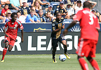 Danny Mwanga #10 of the Philadelphia Union moves between Nana Attakora #3 and Fuad Ibrahim #7 of Toronto FC during an MLS match at PPL stadium in Chester, PA. on July 17 2010. Union won 2-1 with a last minute penalty kick goal.
