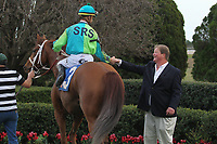 HOT SPRINGS, AR - FEBRUARY 19: Hawaakom #3, with jockey Corey Lanerie aboard being congratulated by trainer Wesley Hawley in the winners circle after winning the Razorback Handicap at Oaklawn Park on February 19, 2018 in Hot Springs, Arkansas. (Photo by Justin Manning/Eclipse Sportswire/Getty Images)