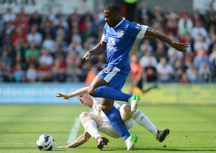 Swansea City's Alan Tate slides in on Everton's Victor Anichebe ..Football - Barclays Premiership - Swansea City v Everton - Saturday 22nd September 2012 - Liberty Stadium - Swansea..