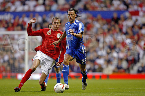 16 August 2006: England striker Peter Crouch challenges for the ball with Papaskevas Antzas during the International Friendly between England and Greece played at Old Trafford, Manchester. England went on to win the game 4-0. Photo: Neil Tingle/actionplus..060816 football soccer player