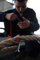 071117-N-7981E-136 Pacific Ocean (November 17, 2007)- Seaman Joseph Paul of Deck Department affixes new tags to mooring lines with a sailing needle and marlinspike on the fantail of Nimitz-class aircraft carrier USS Abraham Lincoln (CVN 72) after getting underway from Naval Air Station North Island. Lincoln departed NAS North Island after unloading equipment and personnel from Carrier Air Wing (CVW) 2 following successful completion of Composite Training Unit Exercise (COMPUTEX).  U.S. Navy photo by Mass Communication Specialist 3rd Class James R. Evans (RELEASED)