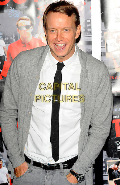 George Russo.Turnout - UK film premiere, Genesis Cinema, Mile End Road, London, England..September 12th, 2011.half length black grey gray suit jacket shirt black tie hands in pockets mouth open.CAP/CJ.©Chris Joseph/Capital Pictures.