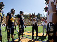 California captains' Kendrick Payne, Robert Mullins, Eric Stevens, Tyler Rigsbee and Southern Utah captains watch Referee Michael Mothershed tosses a coin during coin toss before the game at Memorial Stadium in Berkeley, California on September 8th, 2012.   California Golden Bears defeated Southern Utah, 50-31.
