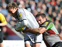 Twickenham, England. Toby Flood of Leicester Tigers tackled during the Aviva Premiership game between Harlequins and Leicester Tigers at Twickenham Stoop, London, England. 21 April 2012.