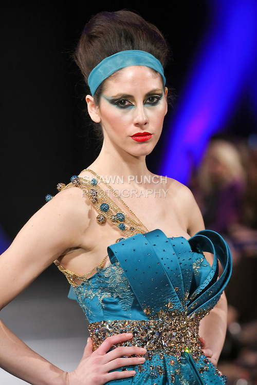 Model walks runway in an outfit from the Haya Al Houti Fall 2011 collection, during Couture Fashion Week Fall 2011 in New York.