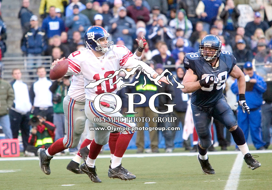 27 Nov 2005:    New York Giants quarterback Eli Manning fired a pass down field against the Seattle Seahawks at Quest Field in Seattle, WA.