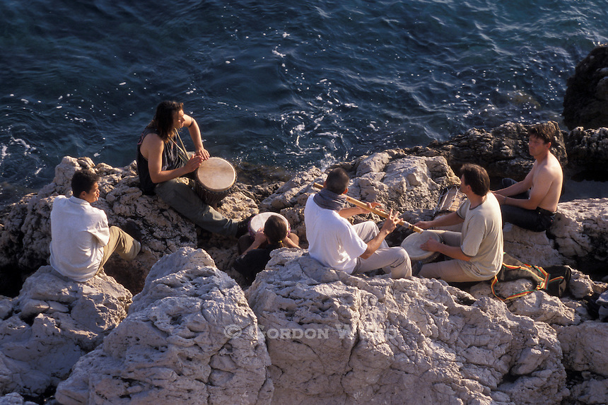 Musicians on Rocks next to Mediterranean Nice France